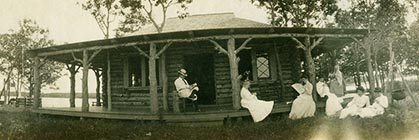 F.M.Smith and guests on Cedar Island cabin porch